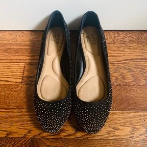 Black suede flats with gold dot accents